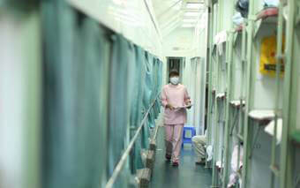 A nurse prepares an operating room on one of four trains that travel through China to provide free cataract operations.