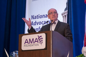 Pfizer's Jack Watters, Vice President, External Medical Affairs, accepts an award on the company's behalf from the AMA
