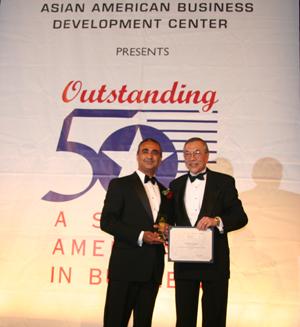 Bob Miglani receives his award from John Wang, CEO of the Asian American Business Development Center.