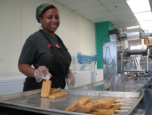 Sharlena Powell makes rhubarb chamomile popsicles at People's Pops in the former Pfizer Brooklyn facility