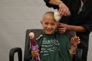 Taylor Mitchell is all smiles as she gets her head shaved