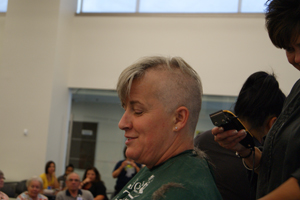 Pfizer colleague Hope Buchanan gets her head shaved for the fifth consecutive year in support of St. Baldrick's Foundation