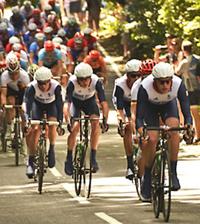 Olympic cyclers near Pfizer's Walton Oaks site